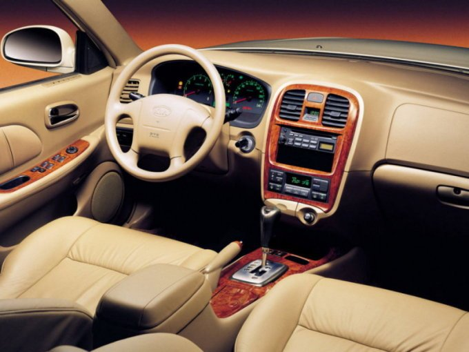 Салон Kia Magentis 2001-2003. Бежевая расцветка – привилегия корейских автомобилей